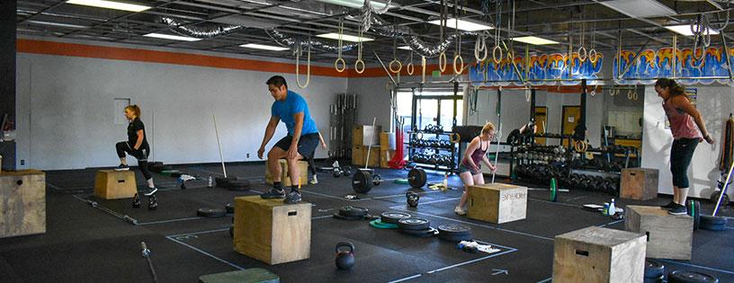 CrossFit class performs box jumps at CrossFit Alaska.