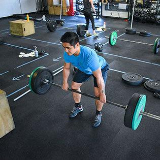 Male member deadlifts at CrossFit Alaska.