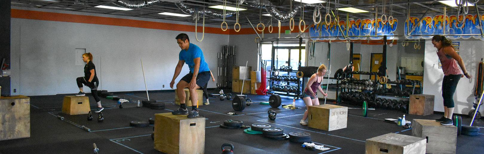 Class performs box jumps at CrossFit Alaska.