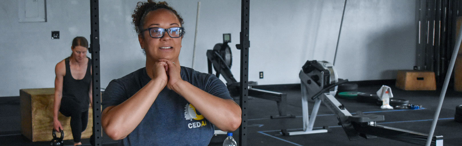 Two female members work out at CrossFit Alaska.