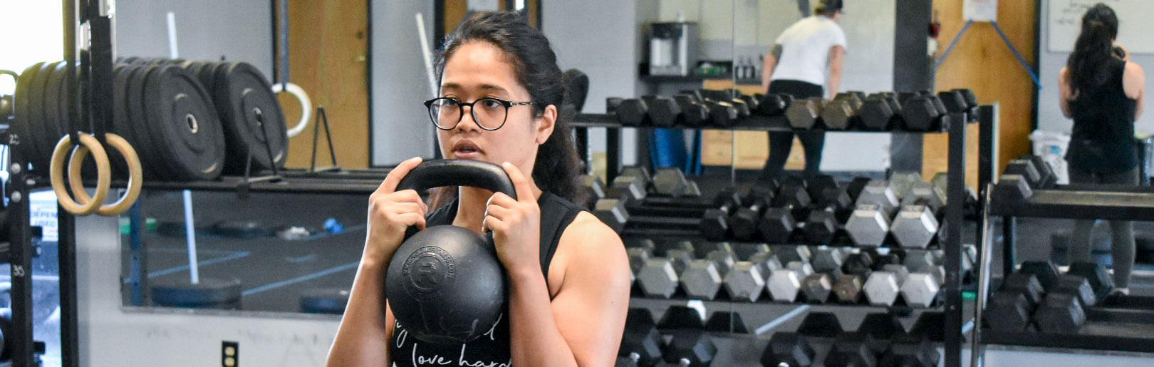 Member performs goblet squats at CrossFit Alaska.