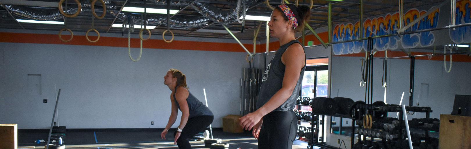 Two female members work out at CrossFit Alaska.