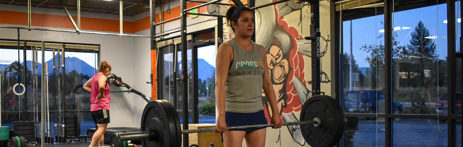 Female member deadlifts at CrossFit Alaska.