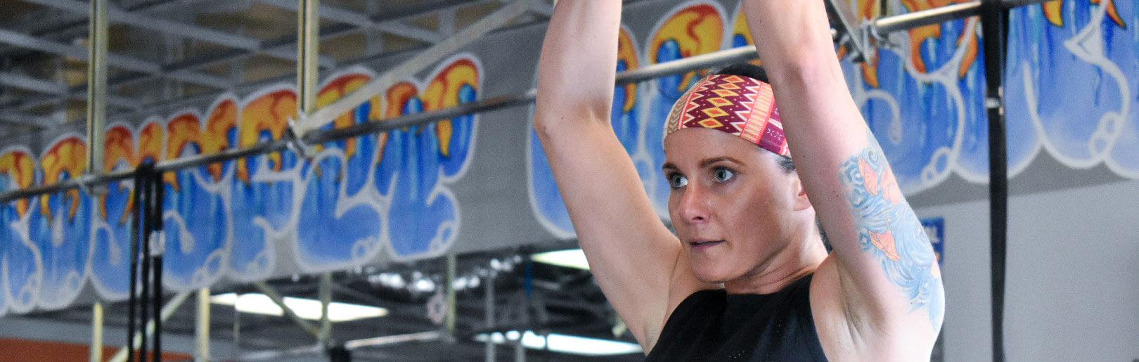 Female member performs kettlebell swings at CrossFit Alaska.