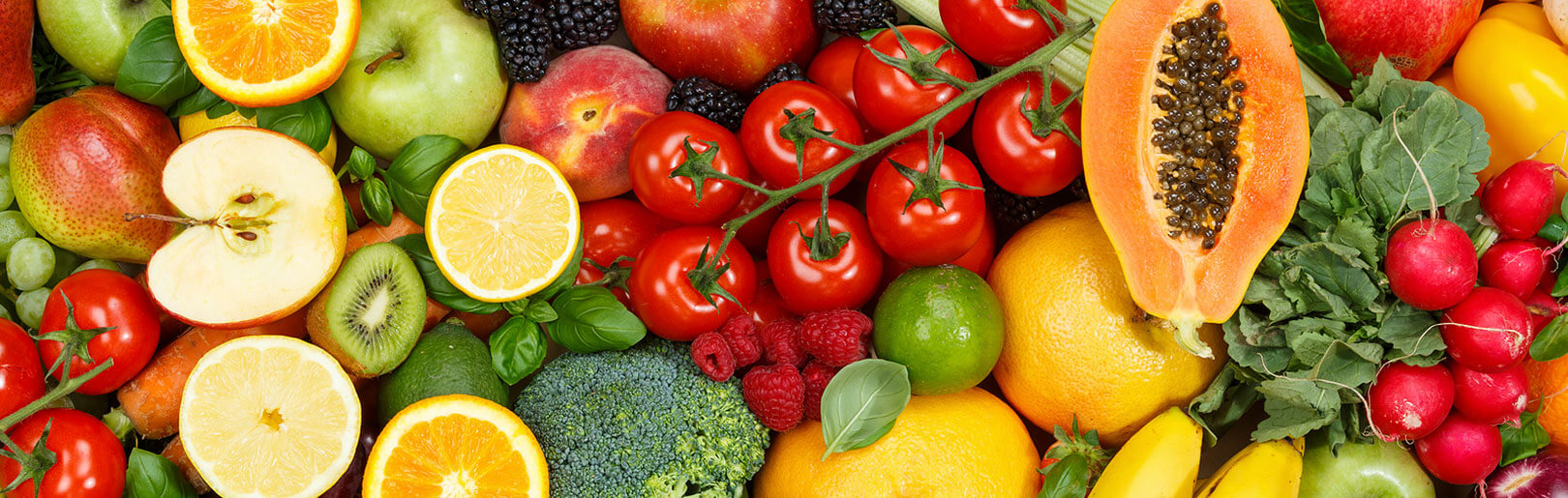 Colorful array of fruits and veggies recommended with nutritional coaching at CrossFit Alaska.